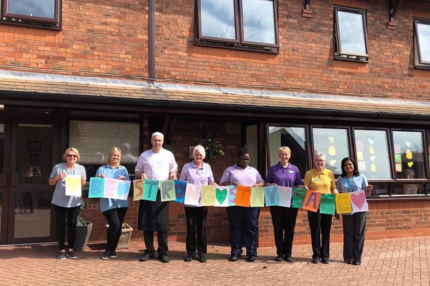 Staff at Lammas House with a message of hope