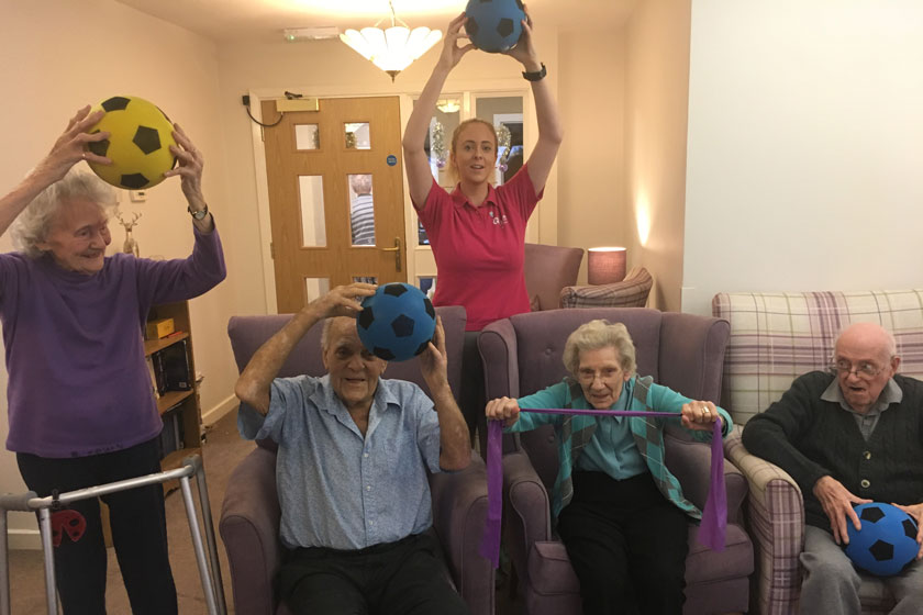 Residents and the GFit Instructor doing their exercises.
