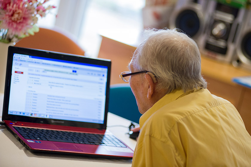 Resident Harry Dye checks his emails in his Sanctuary Care home