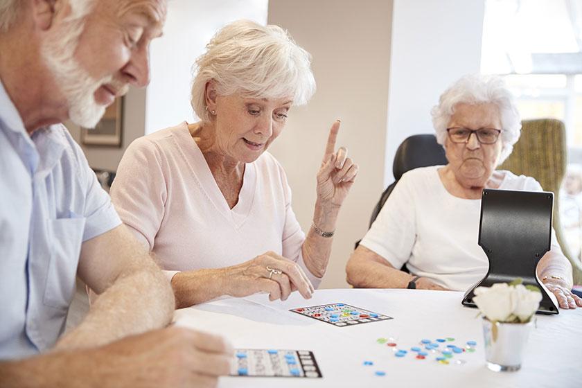 Elderly care residents play bingo