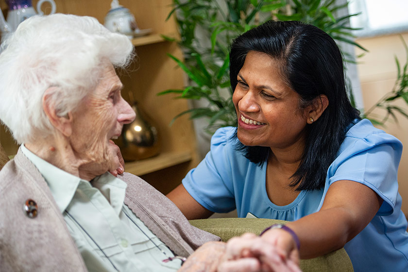 Sanctuary Care home manager chatting with resident