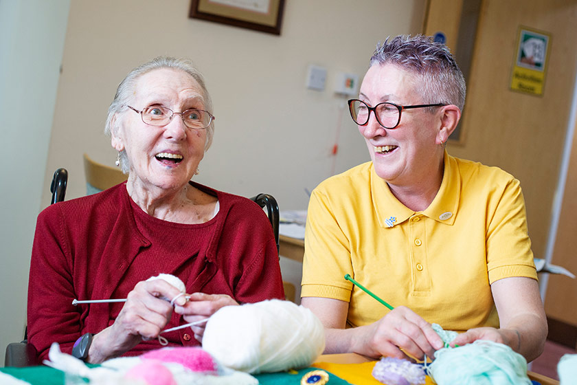 Sanctuary Care staff and resident engage in activities