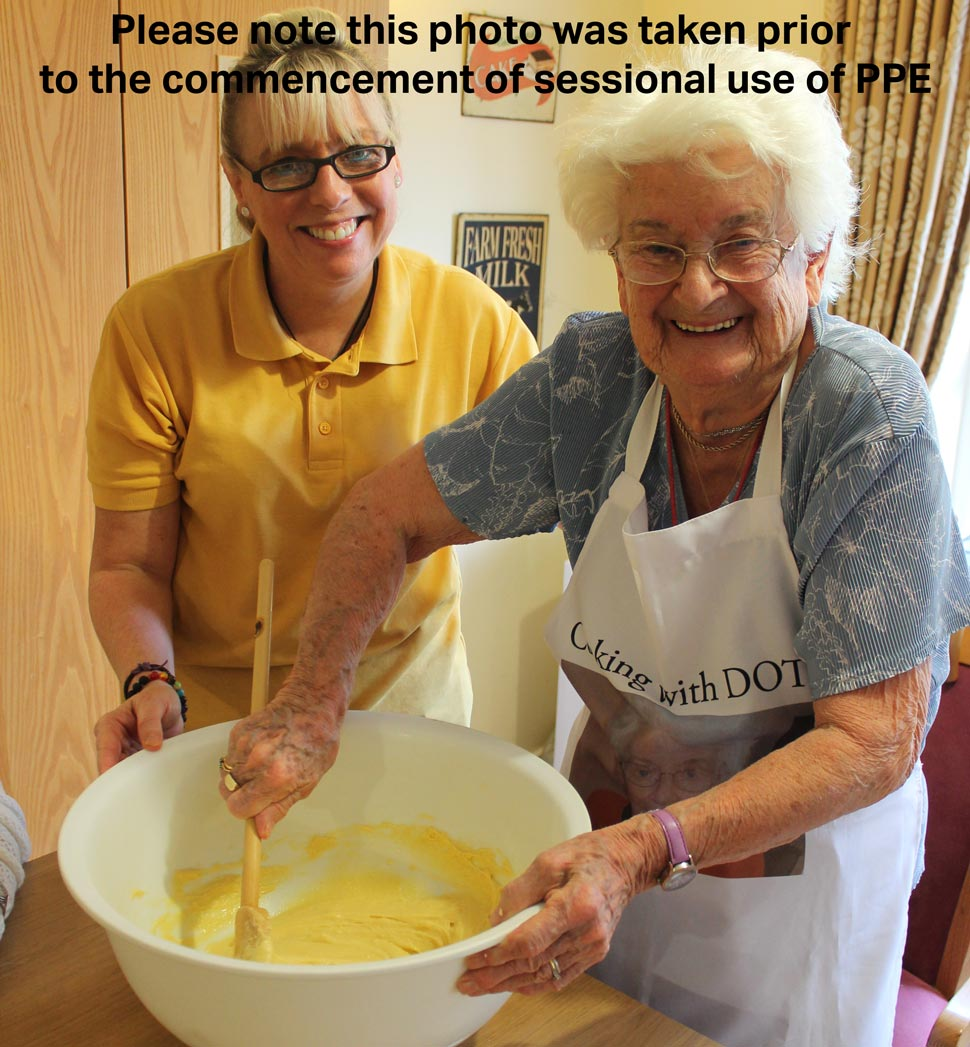 Fiona helping to bake with a resident at Brambles Residential Care Home