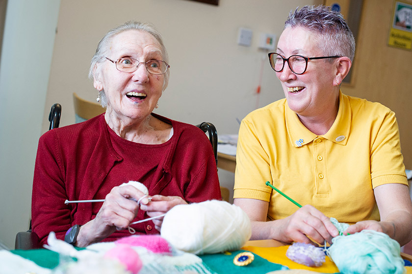 Resident Elsie Knott and Toni Carrigan knitting together