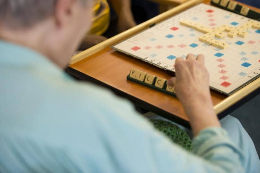 Resident playing scrabble