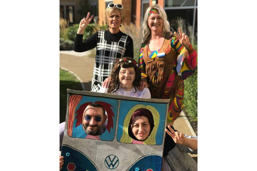 Staff and residents dressed up in swinging sixties fancy dress.