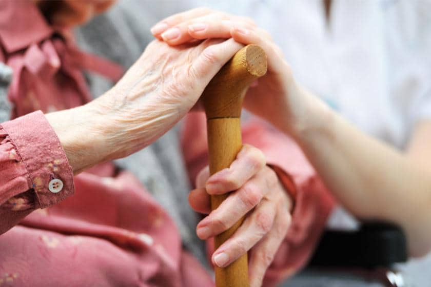 Elderly woman being comforted