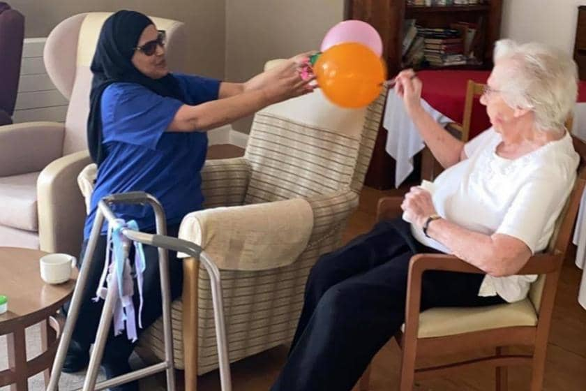 Mary taking part in the light exercise with balloons