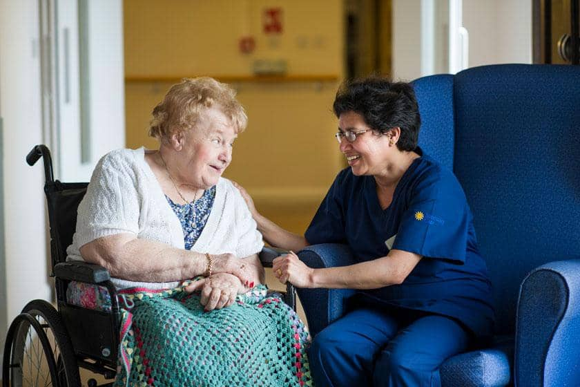 A resident and staff member at Rowanweald Residential and Nursing Home