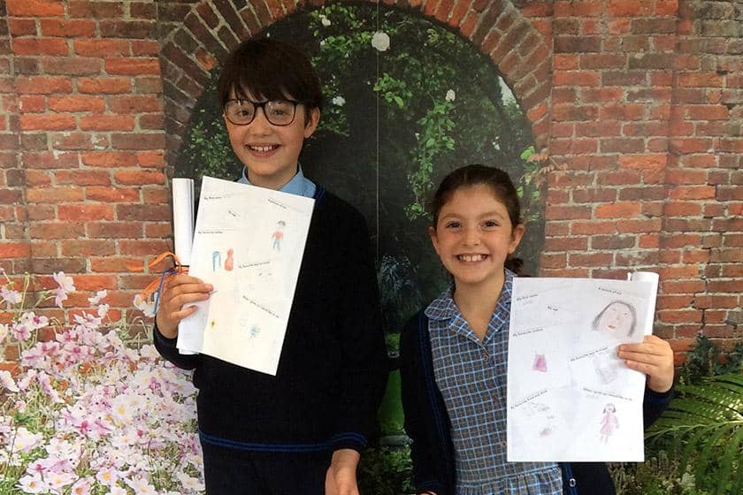 Arthur and and Carina showing off their artwork