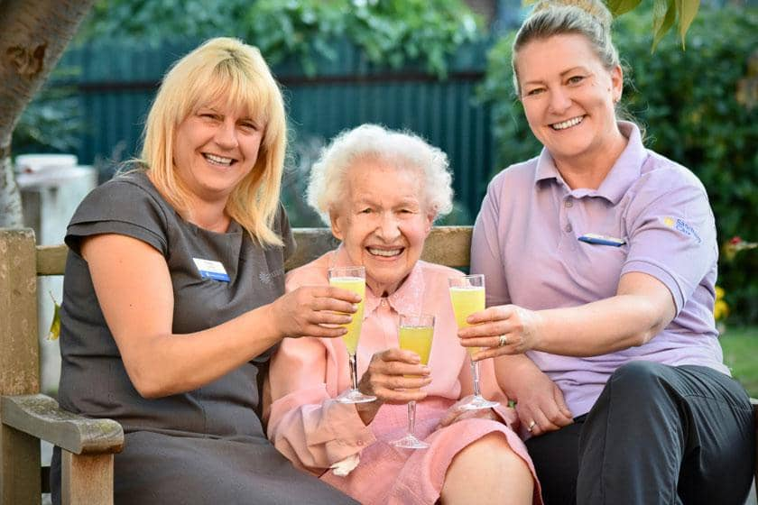 Staff and a resident celebrating at Heathlands Residential Care Home in Pershore.