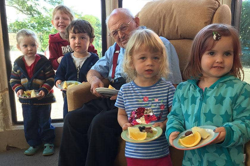 Children with resident George and their fruit.