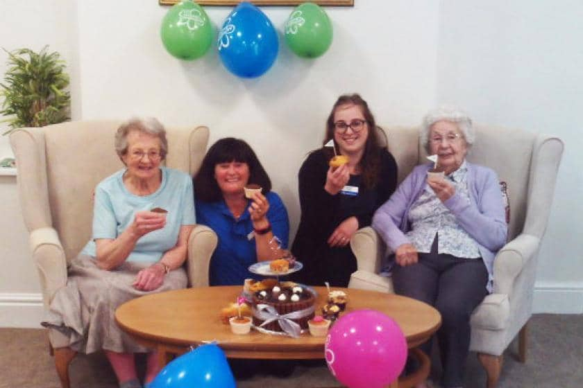 Visitor Briony Corbey, activities leader Suzie Davis, receptionist Sophie Collins and resident June Avery