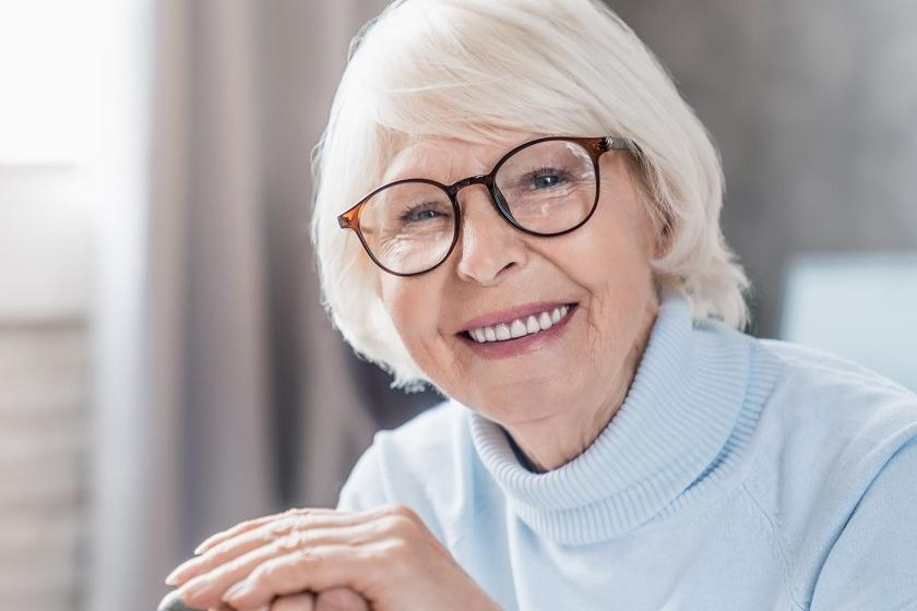 A senior lady is beaming with joy
