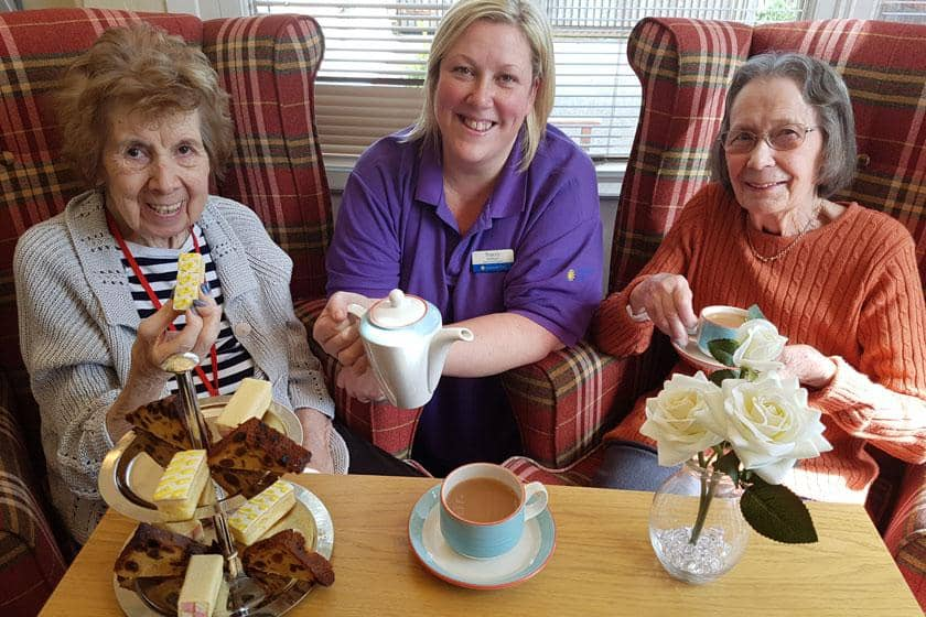 Jenny Hyde, Senior Care Assistant Tracey Sullivan and resident Betty Roe.