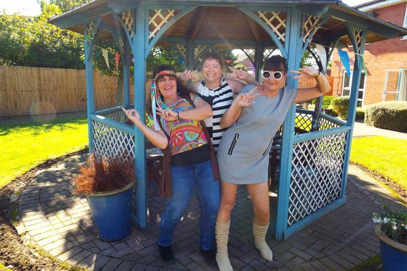 Regent staff dressed up in swinging sixties fancy dress