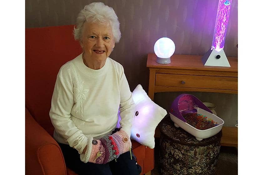 Edna Armitage enjoying the new sensory room.