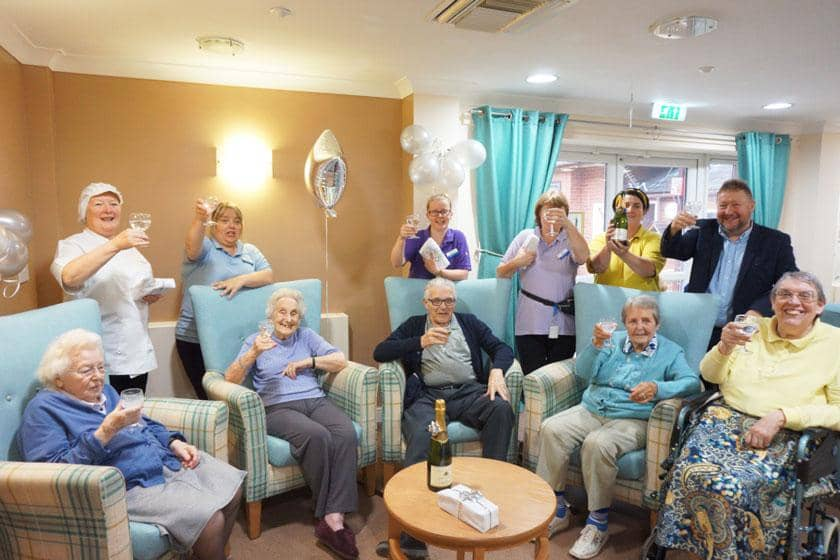 Staff and residents celebrating at Ravenhurst Residential Care Home