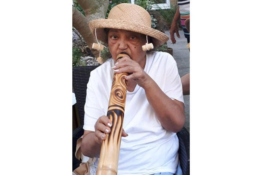 A Rowanweald resident playing a didgeridoo