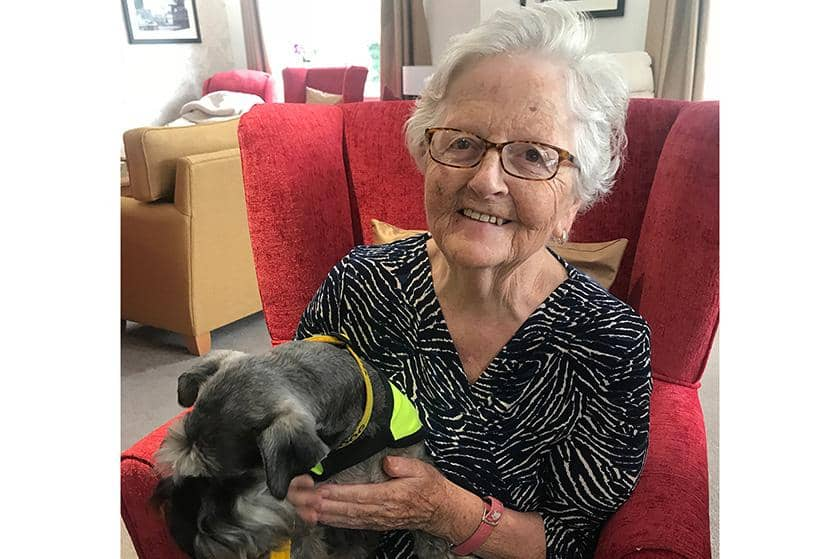 Resident Jean Kostiuk with Bramble the Miniature Schnauzer