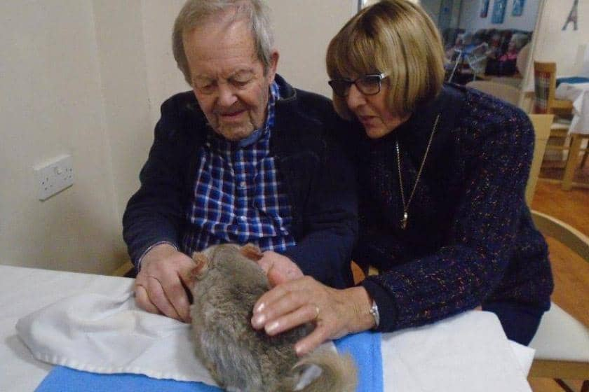 Resident Brian Goodson and his relative Mauricette Goodson with a friendly chinchilla.
