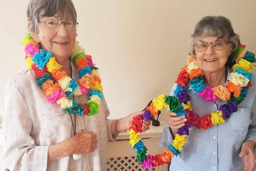 Residents wearing handmade Hawaiian garlands.