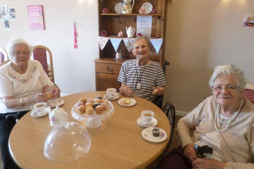 Residents with some of the homemade cakes