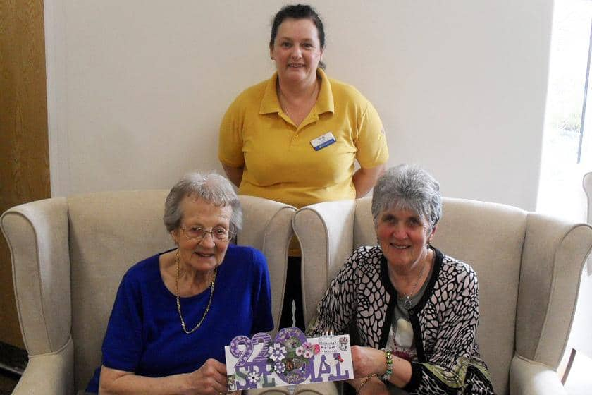 Resident Bryony Corby, activities leader Suzie Davis and visitor Vera Price