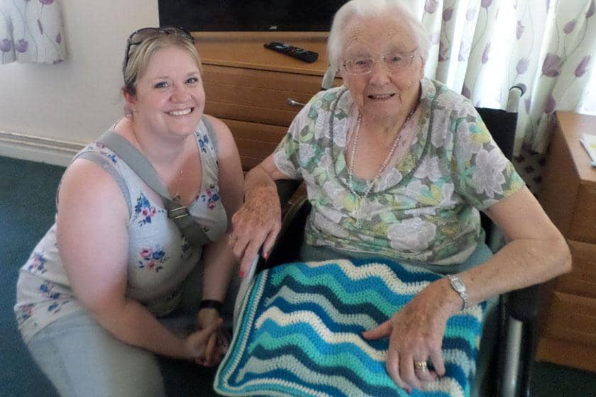Sylvia and Emma with the crochet blanket made by Emma.