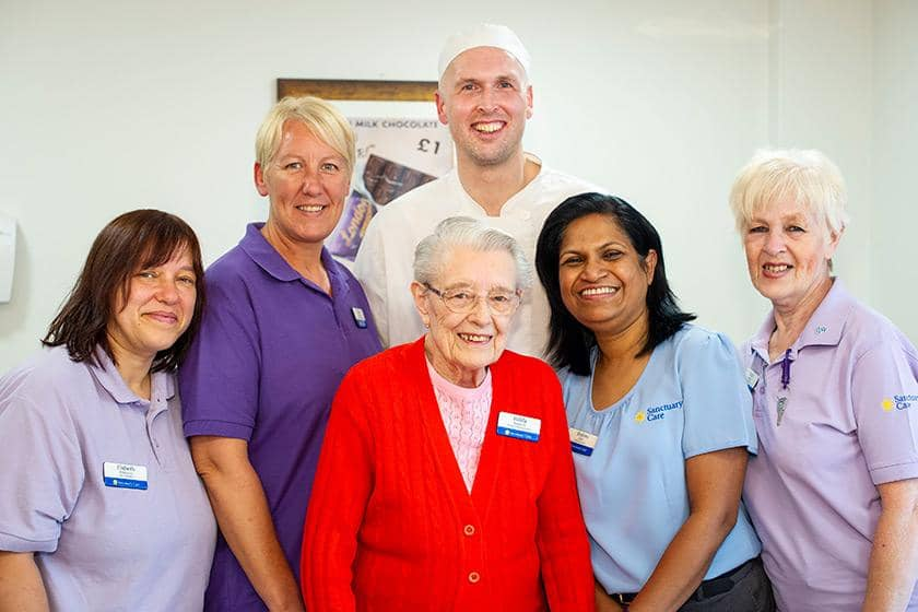 Sanctuary staff with resident Hilda Warwick