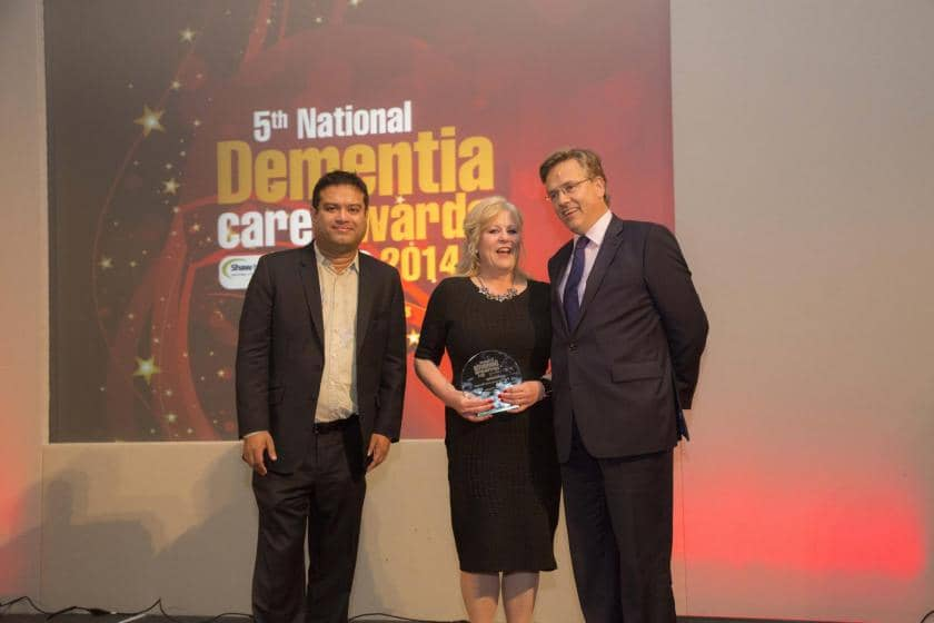 Anita Fletcher, Care Home Manager being presented with a dementia care award.