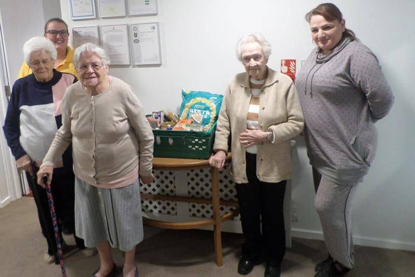 Staff and residents with their donations for Harwich Foodbank.
