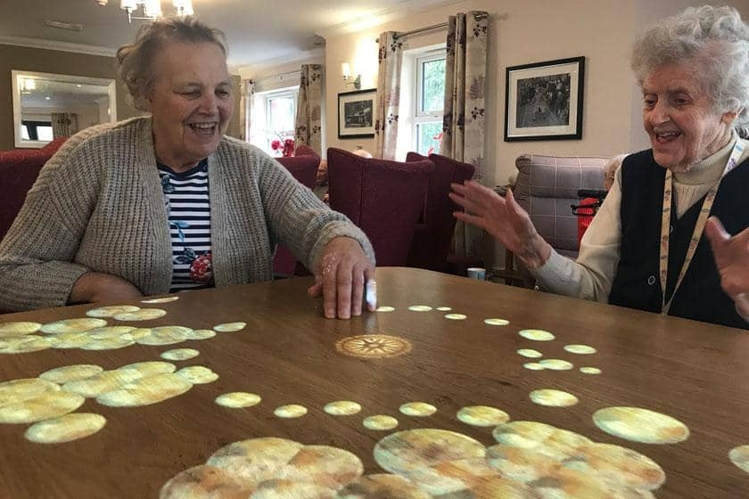 Residents using the new 'Magic Table'