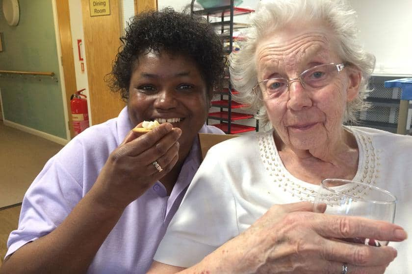 Residents at Rowanweald Residential and Nursing Home taking part in a cheese and wine evening.
