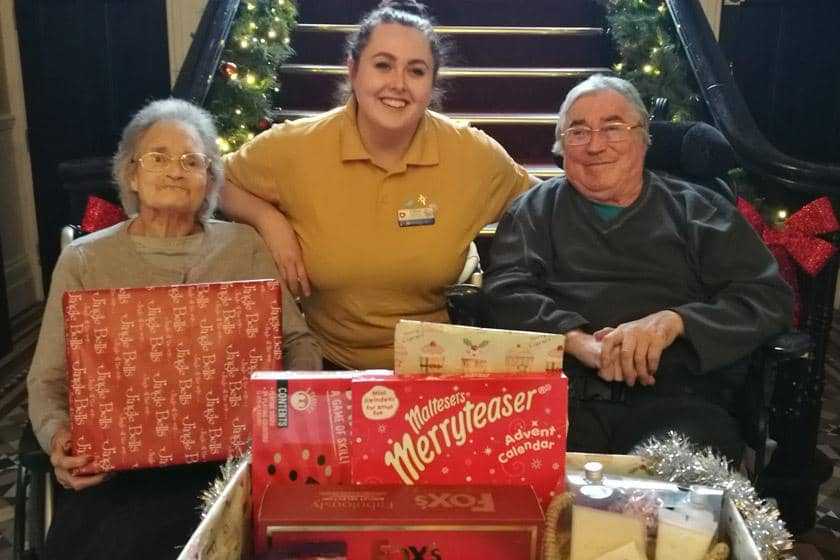Residents Eileen Hicks and Richard Cummins and activities assistant Chloe Hembury.