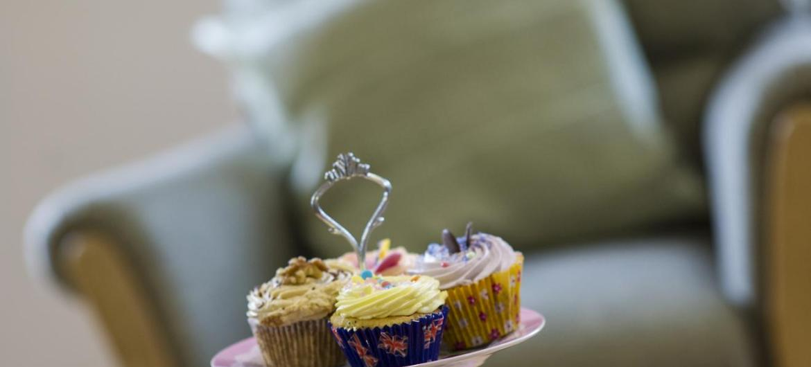 Cup cakes on a pretty cake stand at The Beeches Residential Care Home.