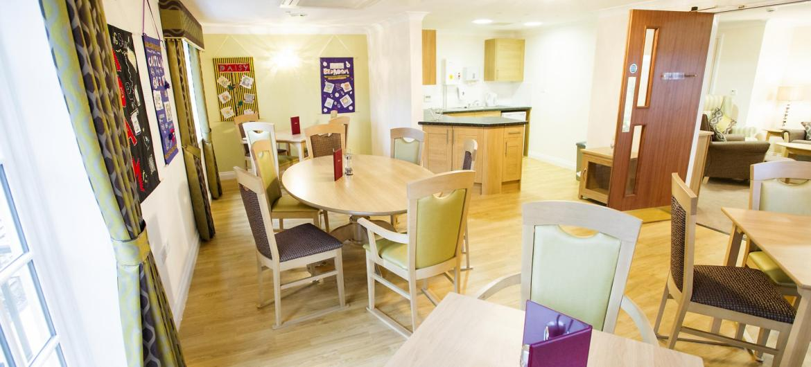 The wooden dining room at Iffley Residential and Nursing Home.