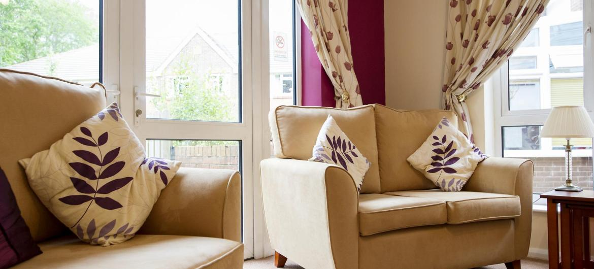 A comfortable and airy lounge at the Ivydene Residential and Nursing Home.