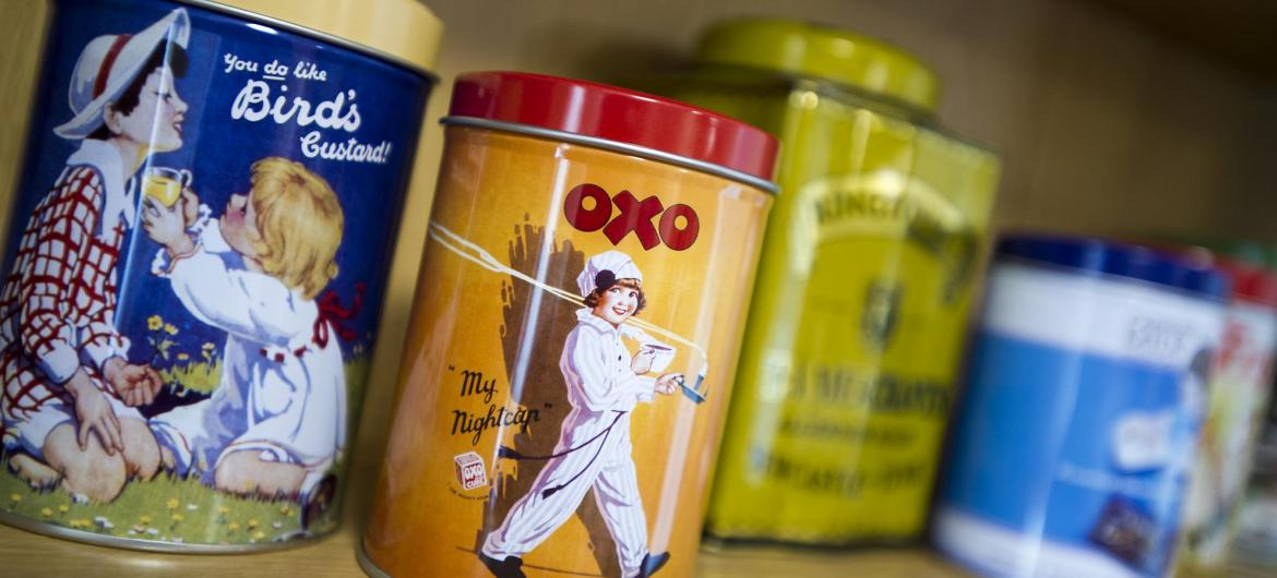 A reminiscence shelf with Birds custard and Oxo tins.