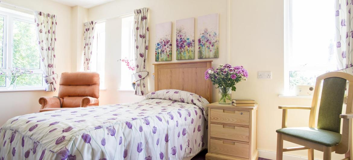 A dual aspect country-style bedroom at Shaftesbury House Residential Care Home.