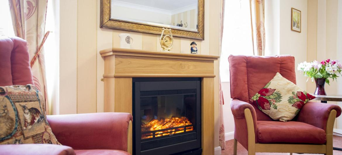 A roaring fire in the lounge at the Ravenhurst Residential Care Home.