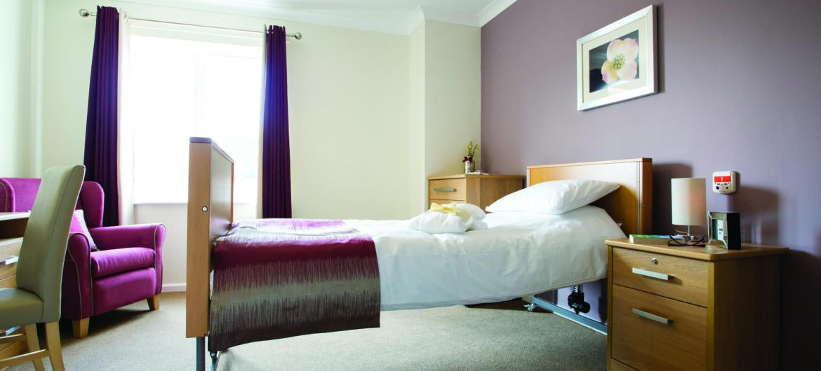 A stylish bedroom in the Juniper House Residential Care Home.