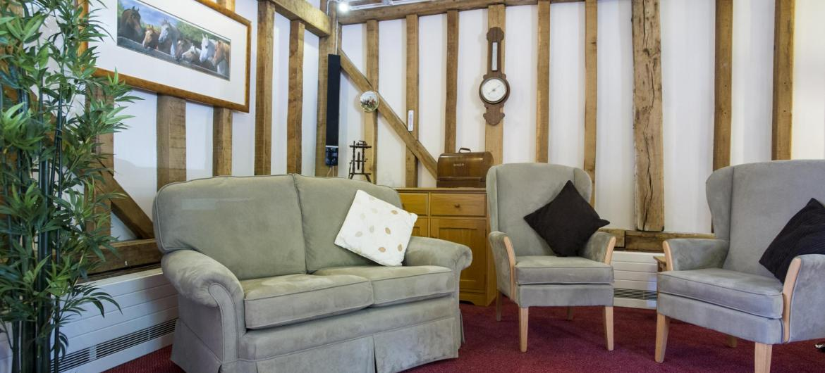The barn lounge with beamed walls at Lyons Court Residential Care Home.