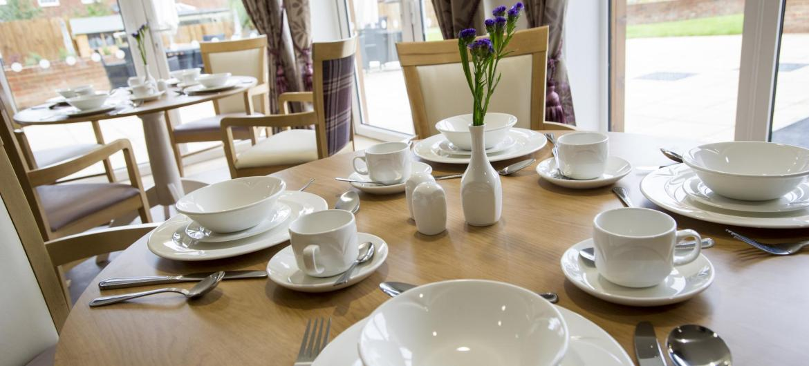The beautifully set dining room tables at Meadow View Residential Care Home.