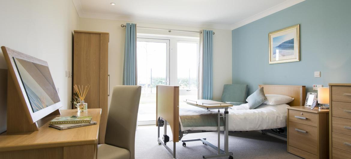 A bright and airy bedroom at Meadow View Residential Care Home.