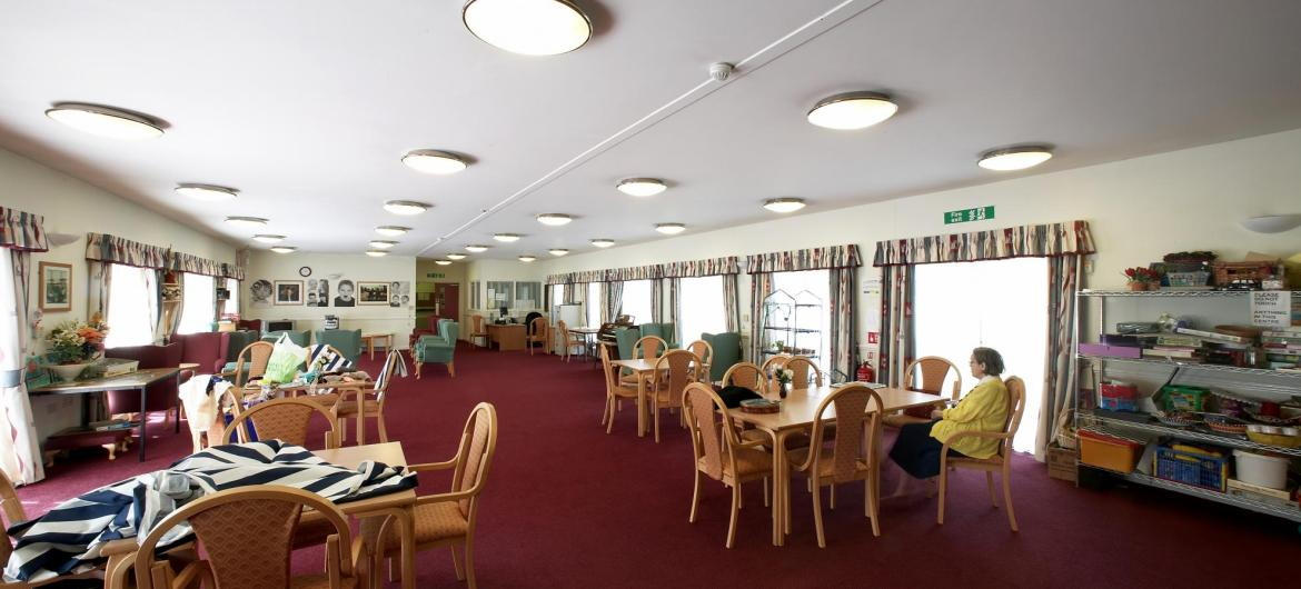 The large and airy dining room at Meadows House Residential and Nursing Home.