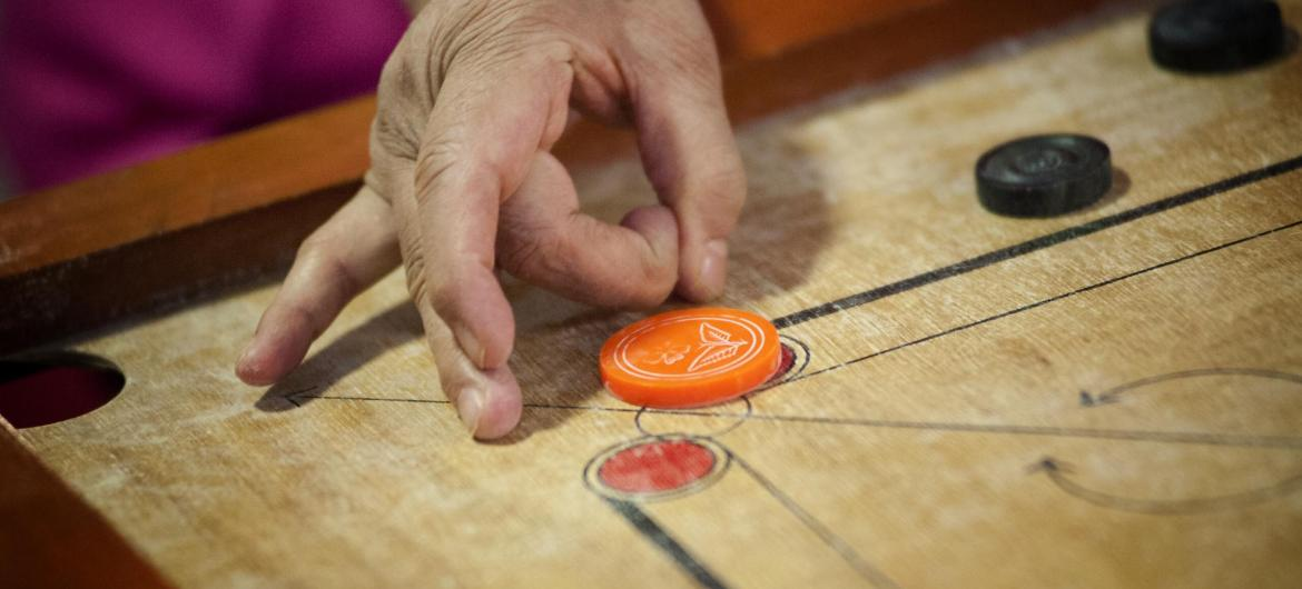 Residents playing Carom.