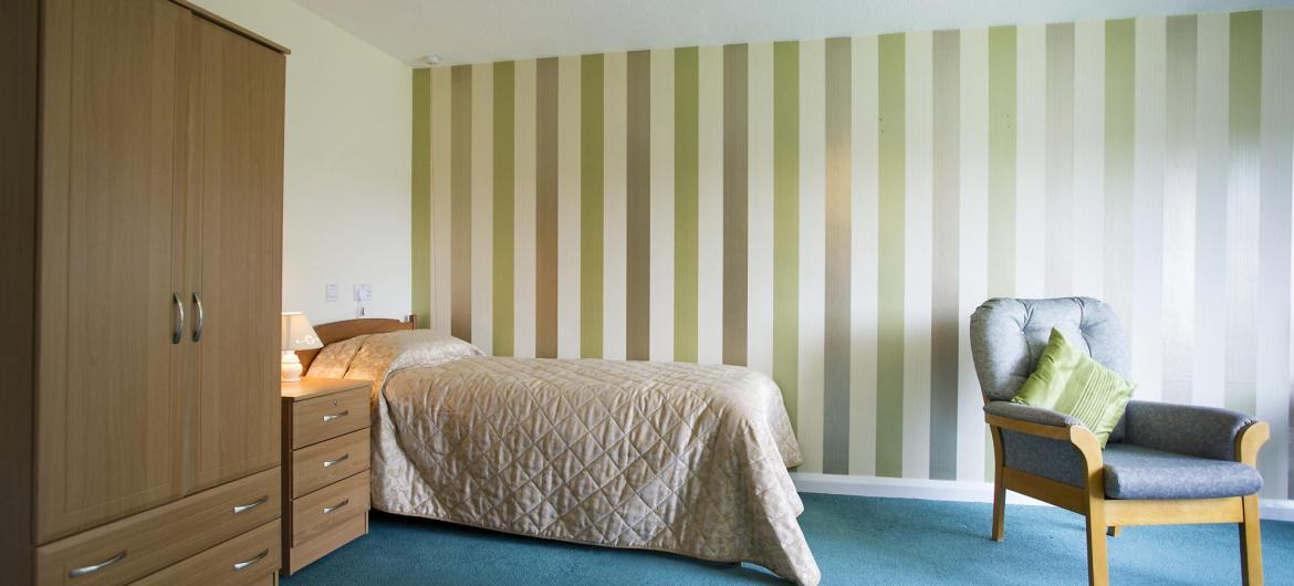 A modern bright and airy en-suite bedroom at Bradwell Court Residential Care Home