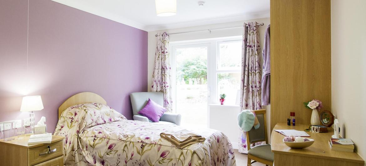 A pretty bedroom at Castlecroft Residential Care Home.