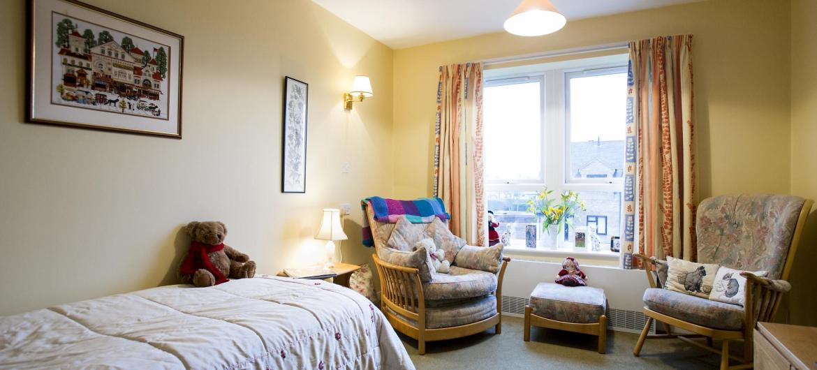 A cosy bedroom at Heathlands Residential Care Home.